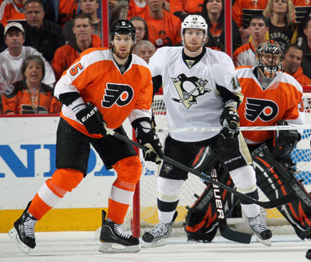 PHILADELPHIA, PA - APRIL 22: Braydon Coburn #5 of the Philadelphia Flyers defends goaltender Ilya Bryzgalov #30 against James Neal #18 of the Pittsburgh Penguins in Game Six of the Eastern Conference Quarterfinals during the 2012 NHL Stanley Cup Playoffs on April 22, 2012 at the Wells Fargo Center in Philadelphia, Pennsylvania.  (Photo by Len Redkoles/NHLI via Getty Images)