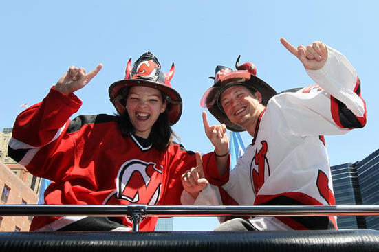 NEWARK, NJ - MAY 19:  Two New Jersey Devils fans arrive for Game Three of the Eastern Conference Final against the New York Rangers during the 2012 NHL Stanley Cup Playoffs at the Prudential Center on May 19, 2012 in Newark, New Jersey.  (Photo by Jim McIsaac/Getty Images)