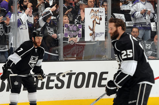 LOS ANGELES, CA - MAY 20:  Fans hold signs as the Los Angeles Kings warm up prior to the game against the Phoenix Coyotes in Game Four of the Western Conference Finals during the 2012 NHL Stanley Cup Playoffs at Staples Center on May 20, 2012 in Los Angeles, California. (Photo by Andrew D. Bernstein/NHLI via Getty Images)